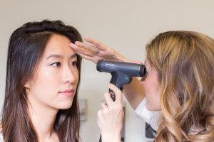 Photo of a physician assistant giving an eye exam