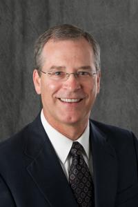 Dr. Paul James